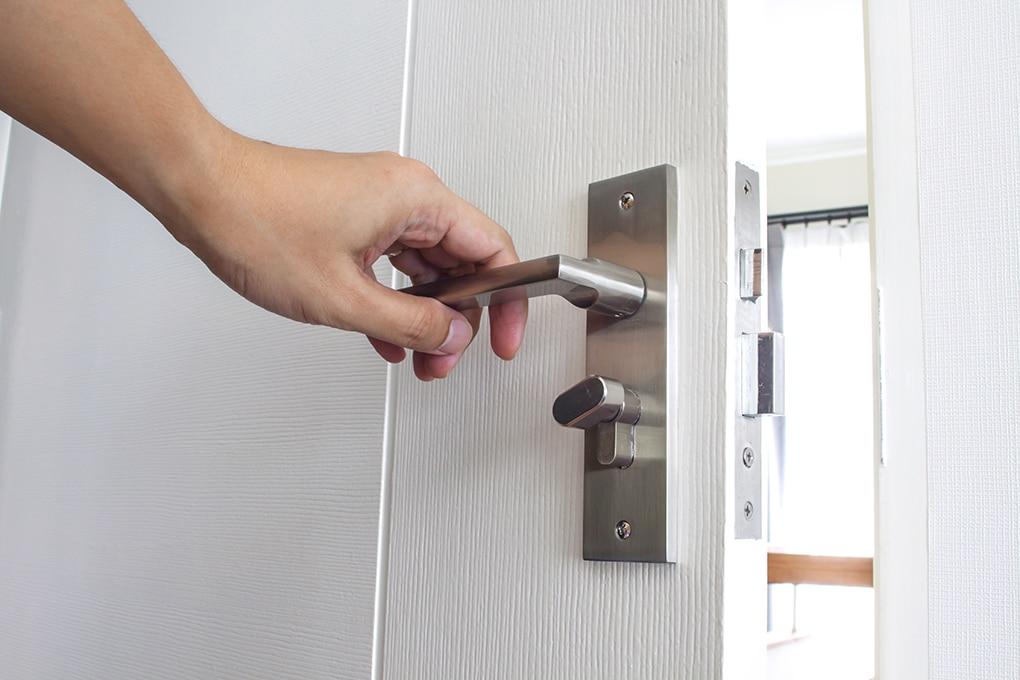 Man hand open doorknob in house.